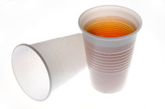 Plastic glasses with a drink Royalty Free Stock Photos