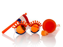Plastic glasses horn flute and flag in orange color Royalty Free Stock Photos
