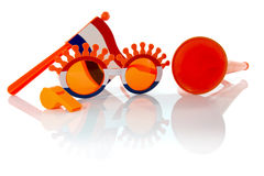 Plastic glasses horn flute and flag in orange color Stock Images