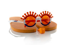 Plastic glasses horn flute slippers  and flag in orange Stock Photography
