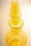 Plastic glasses yellow Royalty Free Stock Image