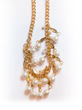 Plastic gold necklace. On a white background Royalty Free Stock Images