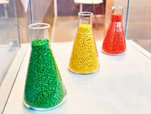Plastic granular polymer. Samples in flasks Royalty Free Stock Photography