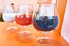 Plastic granular polymer. Samples in flasks Royalty Free Stock Images