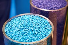 Blue plastic granular polymer. Plastic granular polymer. Samples in flasks Stock Photography