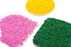 The plastic granules. Polymeric dye isolated on white background. Raw plastic pellets for industry.  Royalty Free Stock Image