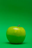 Apple Middle on Green Royalty Free Stock Photos