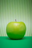 Apple on Green Solid and Stripes Stock Photography