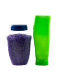 Plastic green bottle and bath salt Royalty Free Stock Photo