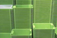 Plastic green containers stacked in several rows royalty free stock photo
