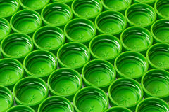 Plastic green cover. Lot of green plastic covers in the background Stock Photos