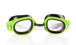 Plastic green goggles for swimming. Isolated on a white background royalty free stock image