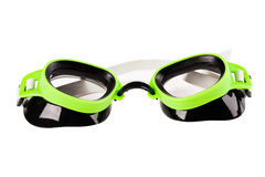 Plastic green goggles for swimming. Isolated on a white background royalty free stock photos