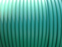 Plastic green rolled up hose or cable wire Royalty Free Stock Photos