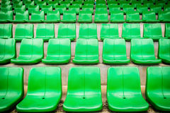 Plastic green seats on football stadium Stock Photos