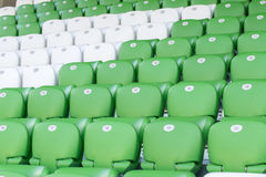 Plastic green and white seats on football stadium Royalty Free Stock Image