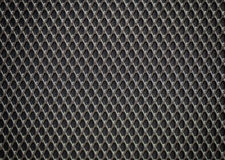 Plastic grille. Grid of audio amplifier background Stock Photography