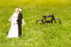 Plastic groom and bride Stock Photos