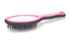 Plastic Hairbrush with Mirror Royalty Free Stock Image