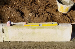 Plastic hammer and spirit level Royalty Free Stock Photos