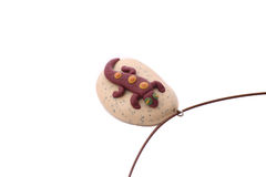 Plastic Hand Made. Plastic pendant handmade lizard on a rock Cable Lock isolated on a white background Stock Image