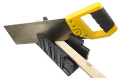 Plastic hand saw and angle cut miter box tool Royalty Free Stock Photos