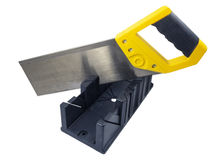 Plastic hand saw and angle cut miter box tool Royalty Free Stock Image