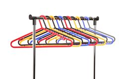 Plastic hangers on a rail Stock Photography