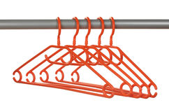 Plastic hangers in row Stock Photos
