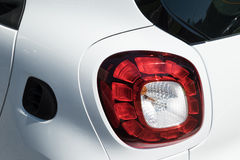 Plastic headlight. N a white car Stock Photography