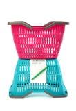 Plastic het winkelen manden met lege het winkelen lijst. Royalty-vrije Stock Foto's