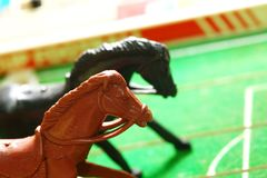Plastic horse model toy in action of run. Plastic horse model toy in action of running represent sport concept Stock Photography