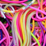 Plastic hose Mardi Gras beads and colorful Stock Image