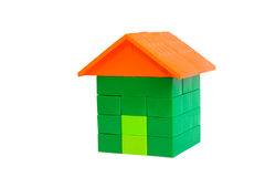 Plastic house. Children\'s toy - a house made of plastic bricks. Isolated on white background, clipping path Stock Photo