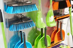 Plastic household brushes and scoops in store. Plastic household brushes and scoops in the hardware store Stock Photos