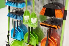 Plastic household brushes and scoops in store. Plastic household brushes and scoops in the hardware store Stock Photography