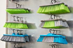 Plastic household brushes in store. Plastic household brushes in the hardware store Royalty Free Stock Photos