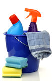 Plastic household bucket with two cleaning bottles. Blue plastic household bucket with two cleaning bottles, a household towel and some cleaning pads on a white stock photo