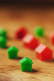 Plastic houses on wooden table Royalty Free Stock Image