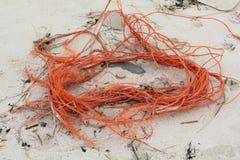 Plastic huisvuil bij de Noordzeekust Stock Foto