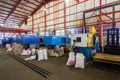Plastic Injection Molding Machines. In operation making customer products for the market Stock Images