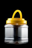 Plastic jar. On black background Stock Image