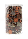 Plastic jar filled with loose change Royalty Free Stock Photo