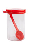 Plastic jar with a spoon inside Royalty Free Stock Photo