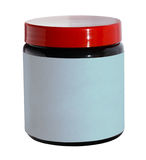 Plastic jar with a white blank label. Stock Image