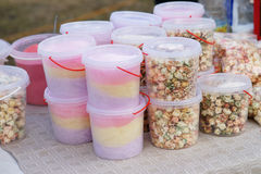 Plastic jars with popcorn and colorful candies Royalty Free Stock Image