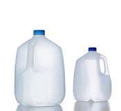 Plastic jugs, recyclable and reusable bottle jug. Plastic jugs, pair of recyclable and reusable bottle jugs containers for water, milk and other liquids with no Stock Image