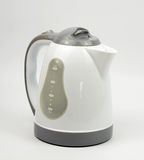 Plastic kettle. On white background royalty free stock photo