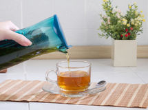 A plastic kettle with tea strainer inside. The easy way to drink tea royalty free stock images