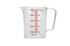 Plastic kitchen measuring cup Royalty Free Stock Photos
